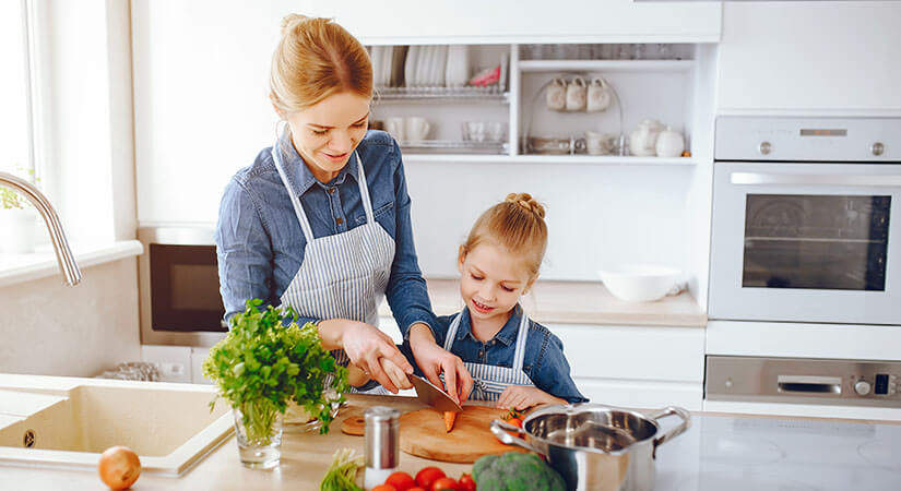 mother teaching types of cooking  her daughter